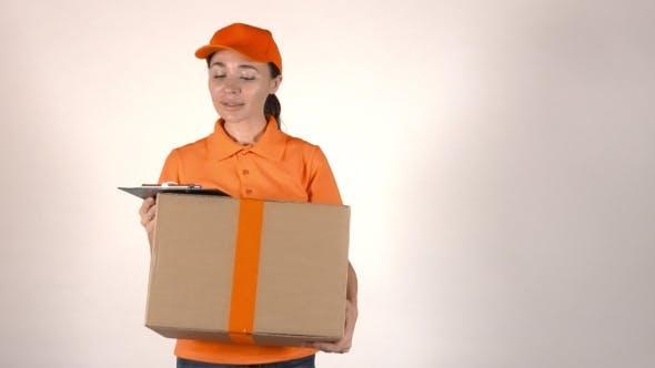Thumbnail for Girl Courier In Orange Uniform Delivering Big Cardboard Parcel