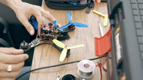 Thumbnail for Man Assembling FPV Drone Using Tools