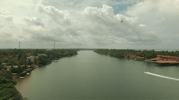 Thumbnail for Helicopter Flying Over River Town