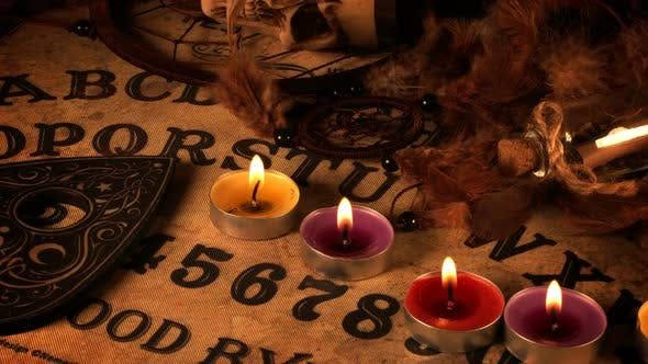 Skull And Candles On Ouija Spirit Board