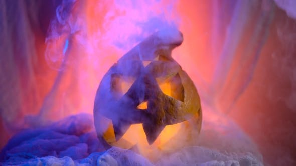 Thumbnail for The Head Of a Pumpkin In a Sinister And Spectacular Illumination, Pumpkin Struetsya Mystic Smoke.