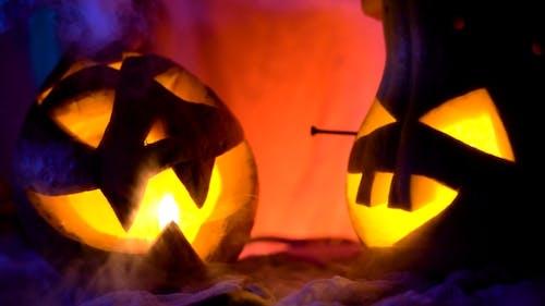 Evil Pumpkin In Night Light Glow, Vapor Or Mist Flowing Around