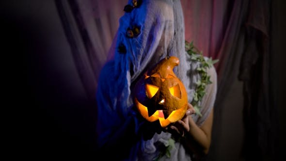 Thumbnail for Halloween Witch With a Magic Pumpkin In a Dark Room