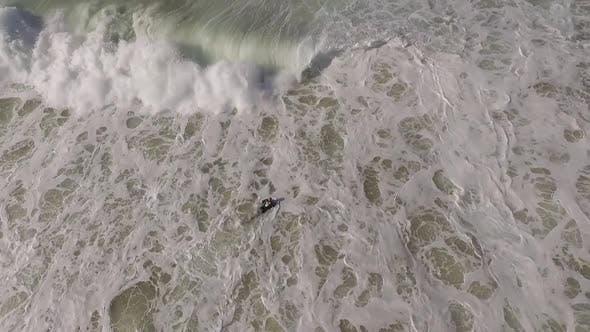 Surfer Struggling in Waves