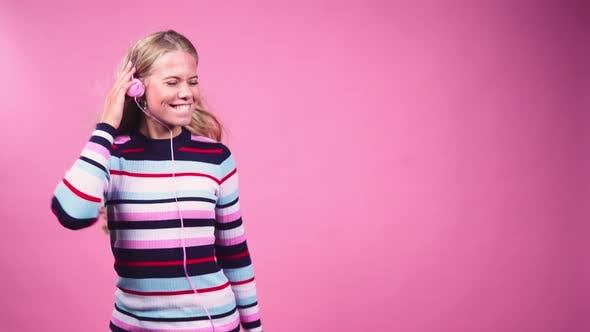 Thumbnail for Teenage Girl with Headphones Dancing
