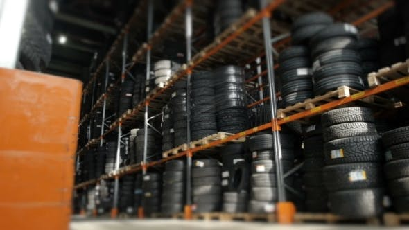 Thumbnail for Car Tires At Warehouse In Tire Store. A Huge Warehouse Of a Car Tires Stored On Shelves