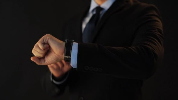 Thumbnail for Businessman Pointing To Smart Watch On His Hand