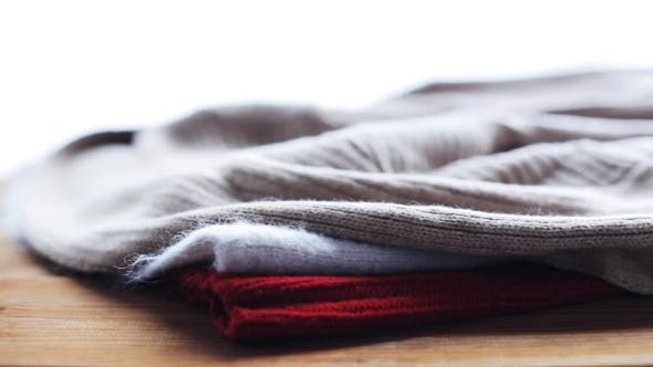 Thumbnail for Knitwear Or Woolen Clothes On Wooden Table At Home