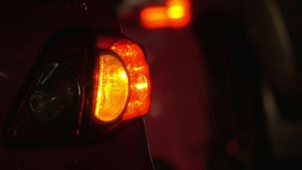 Thumbnail for Car With Hazard Lamps At Rainy Night
