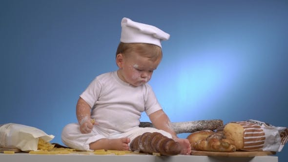 Thumbnail for Baby Baker In Hat Playing With Bread