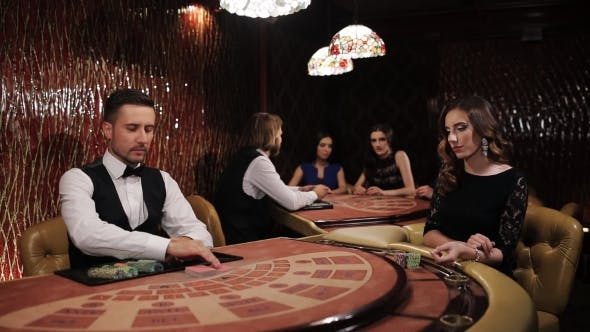 Thumbnail for Elegant Luxury Girl In Black Dress Playing Blackjack In Casino.