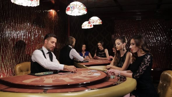 Thumbnail for Two Beautiful Women Playing At The Table Blackjack In a Casino