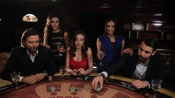 Thumbnail for Elegant Man And Woman Gambling At The Casino. Friends Playing Blackjack