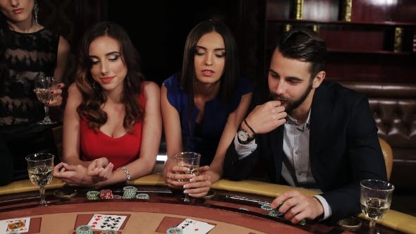 Thumbnail for A Group Of Young And Beautiful People Drink Champagne And Play Casino