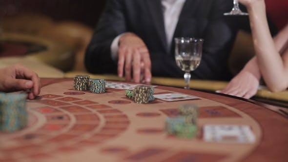 Thumbnail for Playing Blackjack In The Casino. People Make Bets And Win.