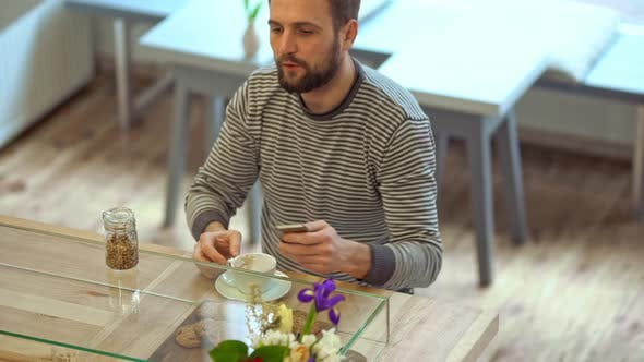 Man Drinking Coffee and Thinking