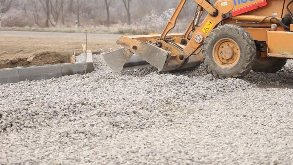 Thumbnail for Bulldozer Spreads Gravel On The Territory