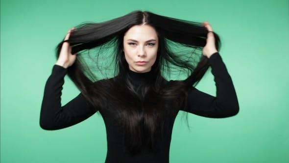 Thumbnail for Brunette Woman Demonstrating Long  Healthy Hair