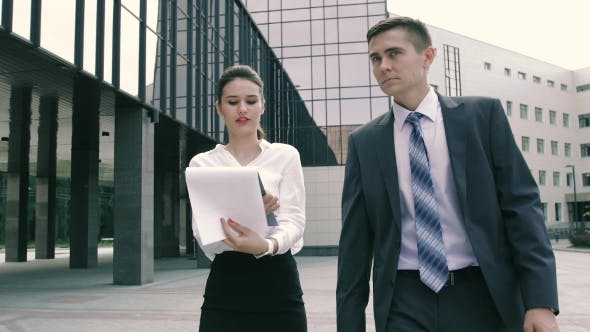 Thumbnail for Confident And Successful Business Partners Doing Business Outdoors On Their Way To Work