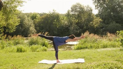 New normal sport outdoor. Young fit sport woman stretching her body in park at sunrise