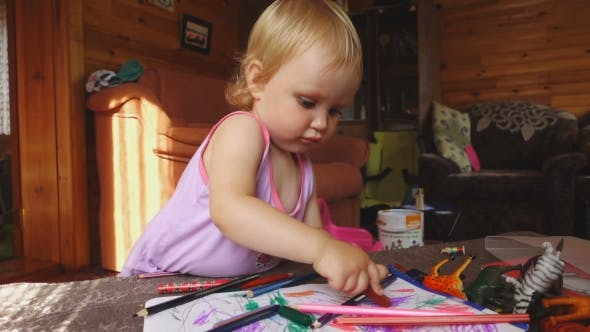 Thumbnail for Sweet Little Girl Draws With Colored Pencils