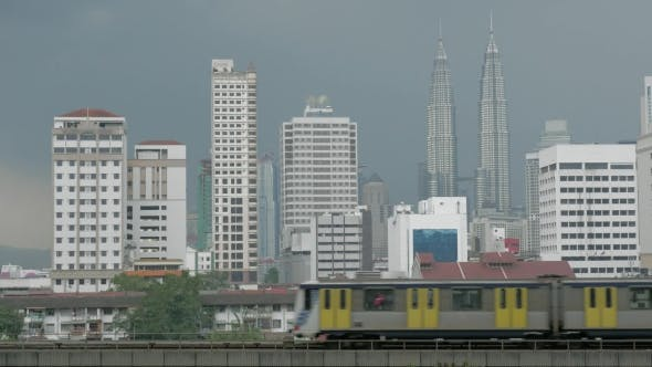 View Of Train On The Foreground And Modern Buildings Skyscraper On The Background. Kuala Lumpur