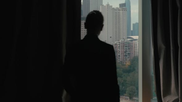 Thumbnail for Clip Of Woman Opening Curtains On The View Of Hong Kong, China