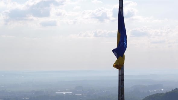 Thumbnail for Ukrainian Flag Flying On Top Of The Beautiful Panorama Of The City