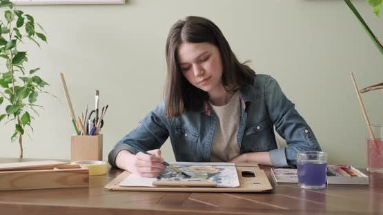 Artist, Teenage Girl, Draws and Records on Video Camera for His Blog