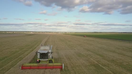 Thumbnail for Aerial Motion Over Operating Thresher at Peak of Harvesting