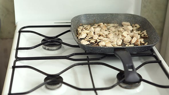 Frying Process of Meat and Mushrooms