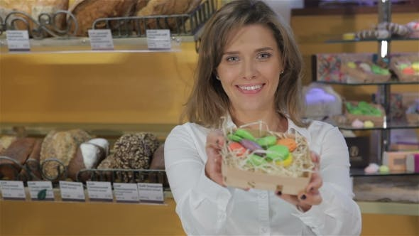 Thumbnail for Woman Show Candies At The Pastry Shop