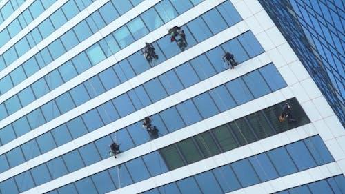 Window Washers Working On Skyscraper