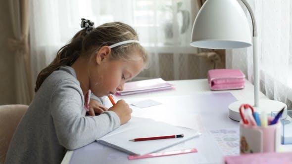 Thumbnail for Little School Girl Doing Homework