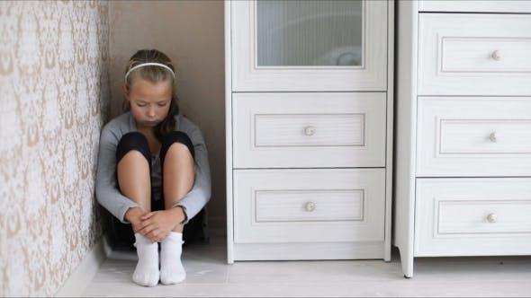 Thumbnail for Little Sad Girl Sitting On The Floor
