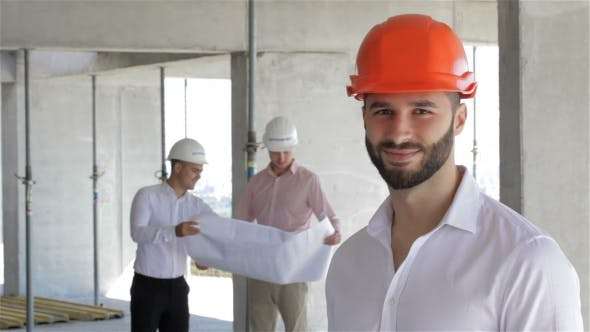 Thumbnail for Construction Engineer Poses At The Building Under Construction
