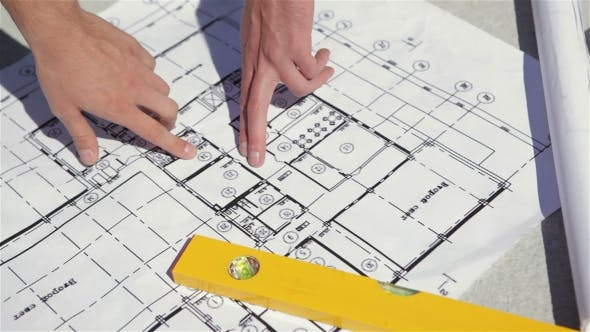Thumbnail for Male Fingers Point At The Plan Of The Building Construction