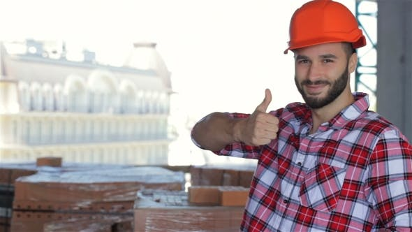 Thumbnail for Male Builder Corrects His Hard Hat At The Building Under Construction
