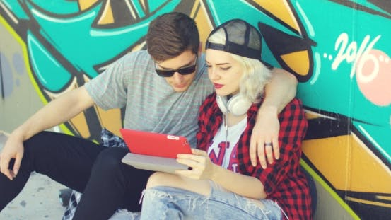Thumbnail for Young Hipster Couple Browsing The Internet