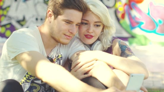 Thumbnail for Loving Trendy Young Couple Taking a Selfie