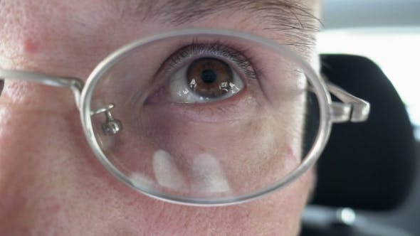 Thumbnail for Person's Brown Eye Through The Metal Glasses