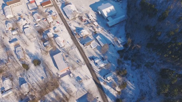 Thumbnail for Above Small Town Covered in Snow
