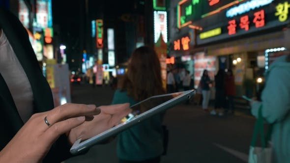 Thumbnail for Woman Browsing In Web On Pad In Night Seoul, South Korea