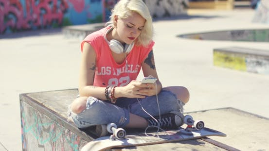 Thumbnail for Trendy Young Blond Woman At a Skate Park