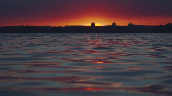Thumbnail for Sunset Over The Water. Interesting Unusual Light.