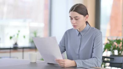 Young Latin Woman Upset By Loss on Documents
