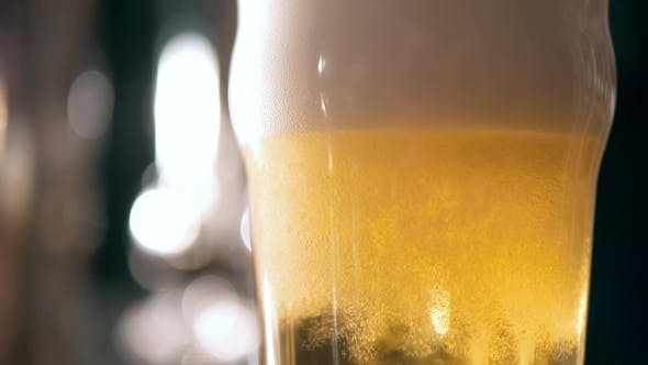 Cover Image for Beer Into Glass With a Lot Of Bubles And Foam Super  .