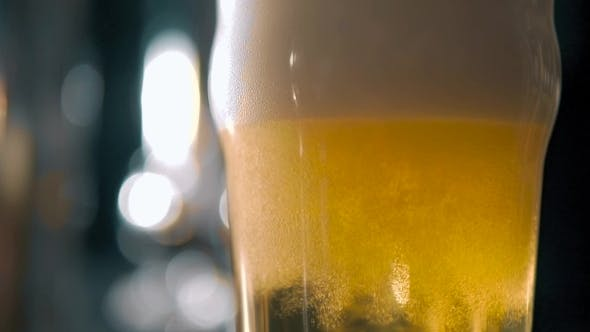 Thumbnail for Beer Into Glass With a Lot Of Bubles And Foam Super  .