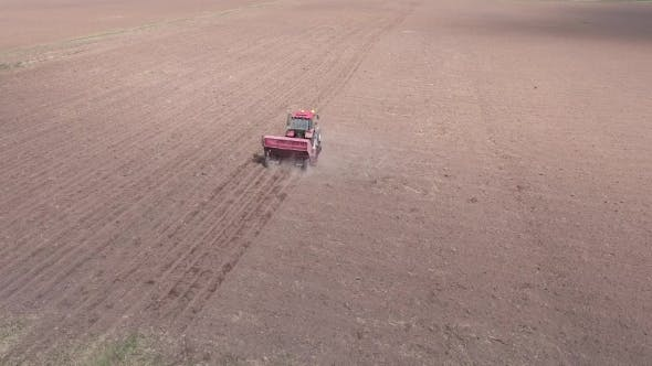 Thumbnail for Aerial Of Tractor On Harvest Field