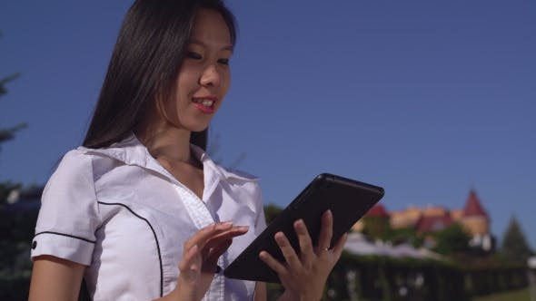 Thumbnail for Successful Businesswoman Wearing In Elegant Shirt With Gadget Outdoors